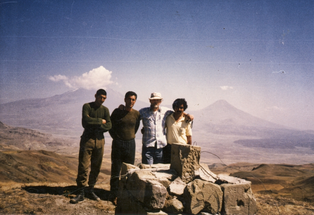 Ron Wyatt in 1984 standing next to marker number 65 which had some of the inscriptions on the stones. The south Iranian side of the marker is partially visible.